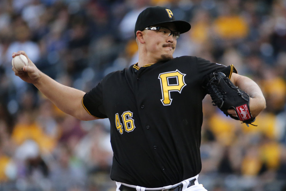 Photo - Pittsburgh Pirates starting pitcher Vance Worley delivers during the first inning of a baseball game against the Arizona Diamondbacks in Pittsburgh, Thursday, July 3, 2014. (AP Photo/Gene J. Puskar)