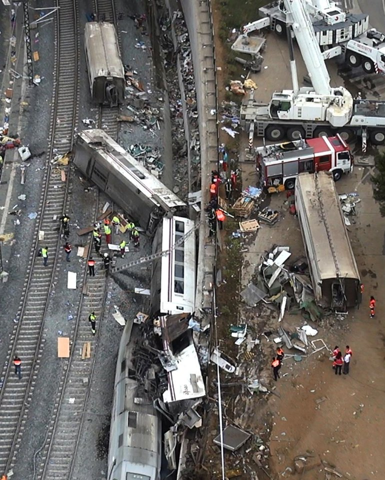 Photo - This aerial image taken from video shows a general view of the site of a train accident in Santiago de Compostela, Spain, on Thursday July 25, 2013. The death toll in a passenger train crash in northwestern Spain rose to 77 on Thursday after the train jumped the tracks on a curvy stretch just before arriving in the northwestern shrine city of Santiago de Compostela, a judicial official said. (AP Photo)