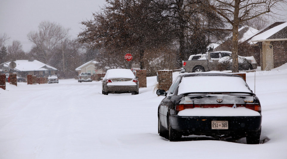 Photo - A residential street is covered in snow in this Midwest City neighborhood near SE 15 and Westminster.  A second winter storm in a week dumped about 6 inches of snow in the Oklahoma City area Tuesday morning, Feb. 9, 2011.   Photo by Jim Beckel, The Oklahoman