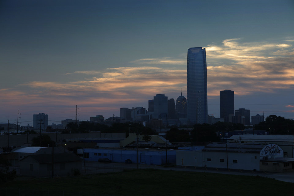 Photo - Sunrise shows the Oklahoma City Skyline on the day of the first game of the NBA basketball finals at the Chesapeake Arena on Tuesday, June 12, 2012 in Oklahoma City, Okla. Photo by Steve Sisney, The Oklahoman  STEVE SISNEY