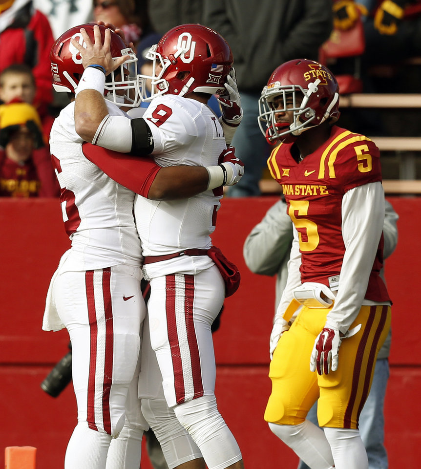 Photo - Oklahoma's Dimitri Flowers (36), left, and Trevor Knight (9) celebrate a touchdown run by Knight near Iowa State's Kamari Cotton-Moya (5) during a college football game between the University of Oklahoma Sooners (OU) and the Iowa State Cyclones (ISU) at Jack Trice Stadium in Ames, Iowa, Saturday, Nov. 1, 2014. Photo by Nate Billings, The Oklahoman