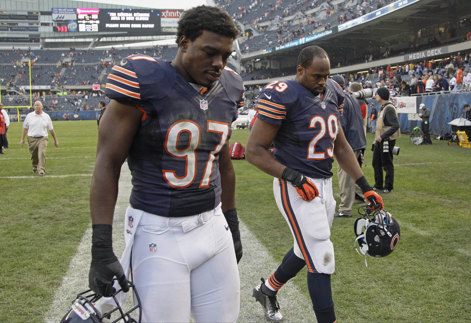 Chicago Bears linebacker J.T. Thomas (97) and running back Michael Bush (29) leave the field after the Bears' 23-17 loss in overtime to the Seattle Seahawks overtime in an NFL football game in Chicago, Sunday, Dec. 2, 2012.  (AP Photo/Nam Y. Huh)