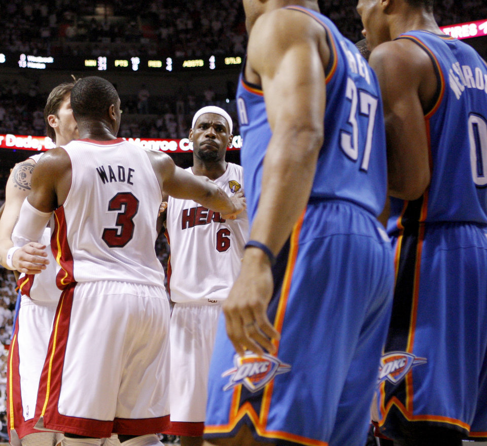 Miami's LeBron James (6) reacts after he was fouled by Oklahoma City's Derek Fisher (37) during Game 5 of the NBA Finals between the Oklahoma City Thunder and the Miami Heat at American Airlines Arena, Thursday, June 21, 2012. Photo by Bryan Terry, The Oklahoman