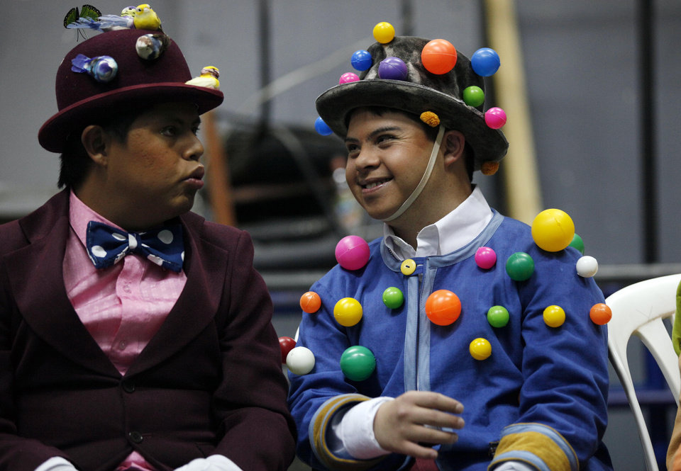 "In this Sept. 21, 2012 photo, cast members dressed in their costumes pass the time backstage as they wait for their stage cue for their performance in ""Suenos,"" or �Dreams,� one of Ecuador's most successful musicals, at the Casa de la Cultura theater in Quito, Ecuador. The musical is based in part on the dreams of young people with disabilities and is presented by the nonprofit foundation El Triangulo. (AP Photo/Dolores Ochoa)"