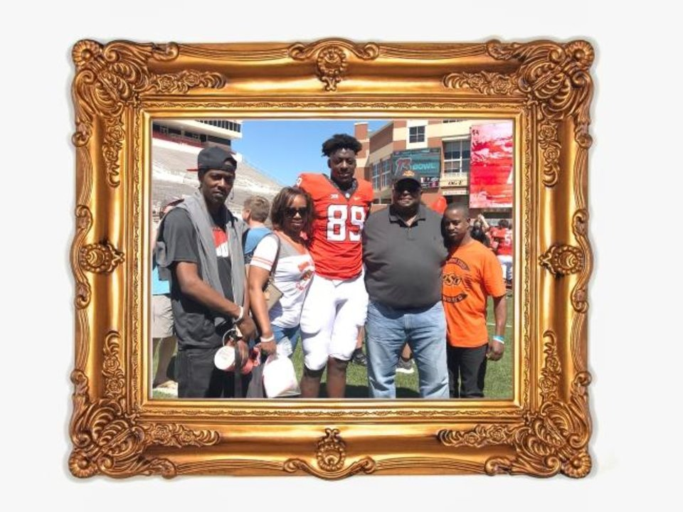 Photo -  Jelani Woods (89) will be spending Thanksgiving with his family for the first time since he arrived in Stillwater. Pictured at OSU's spring game, from left to right, brother Jaleel; mother, Shaheerah; Woods; father, Greg; and brother Jay. [OKLAHOMAN PHOTO ILLUSTRATION]