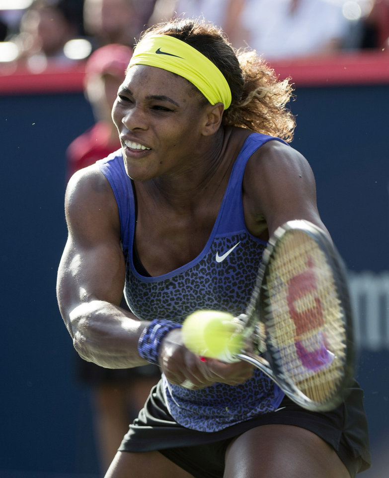 Photo - Serena Williams, of the United States, returns the ball to Lucie Safarova, of the Czech Republic, at the Rogers Cup tennis tournament, Thursday, Aug. 7, 2014, in Montreal. (AP Photo/The Canadian Press, Paul Chiasson)