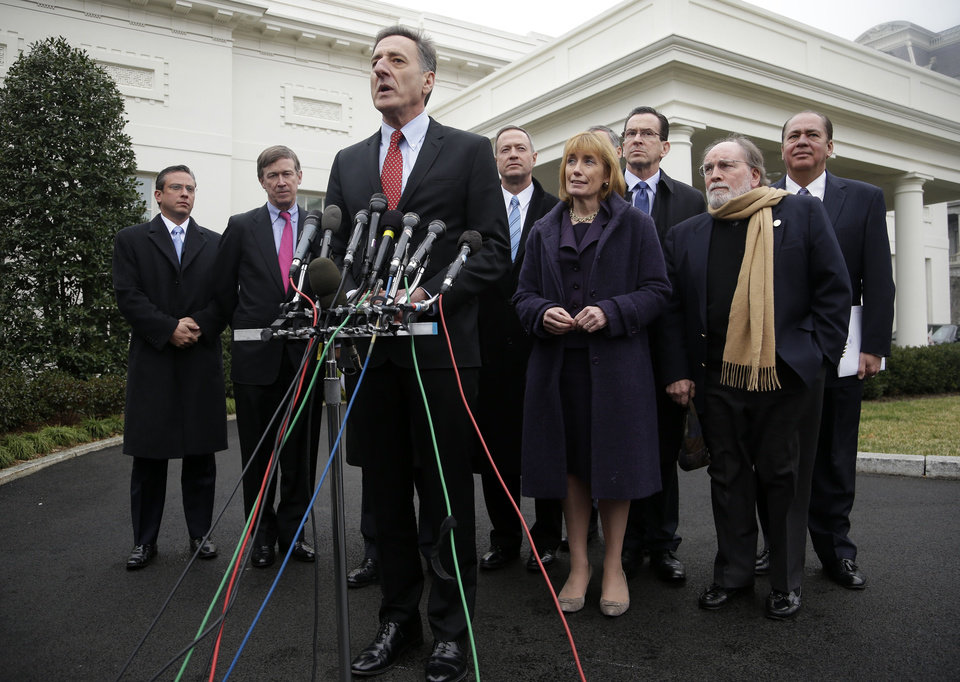 Photo - Vermont Gov. Peter Shumlin, center, accompanied by fellow members of the Democratic Governors Associations, speaks outside the White House in Washington, Friday, Feb. 22, 2013, following their meeting with President Barack Obama and Vice President Joe Biden. From left are, Puerto Rico Gov. Alejandro García Padilla, Colorado Gov. John Hickenlooper, Shumlin, Maryland Gov. Martin O'Malley, New Hampshire Gov. Maggie Hassan, Connecticut Gov. Dan Malloy, Hawaii Gov. Gov. Neil Abercrombie and West Virginia Gov. Earl Ray Tomblin.  (AP Photo/Pablo Martinez Monsivais)