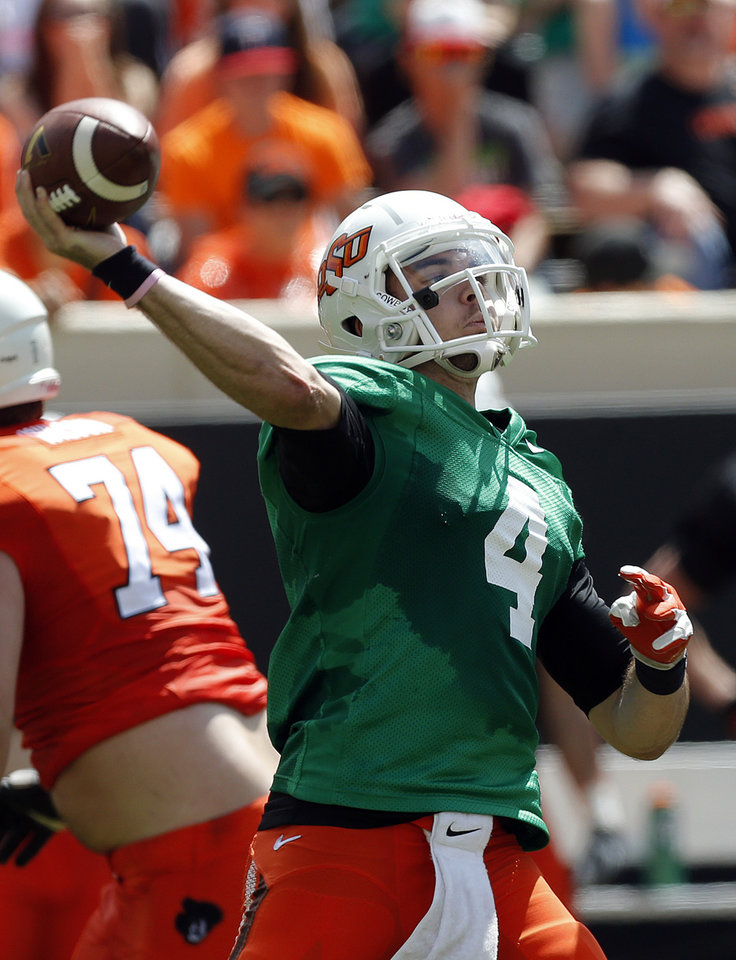 Photo - OSU's J.W. Walsh throws a pass during the Oklahoma State University Spring football game at Boone Pickens Stadium in Stillwater, Okla., Saturday, April, 18, 2015. Photo by Sarah Phipps, The Oklahoman