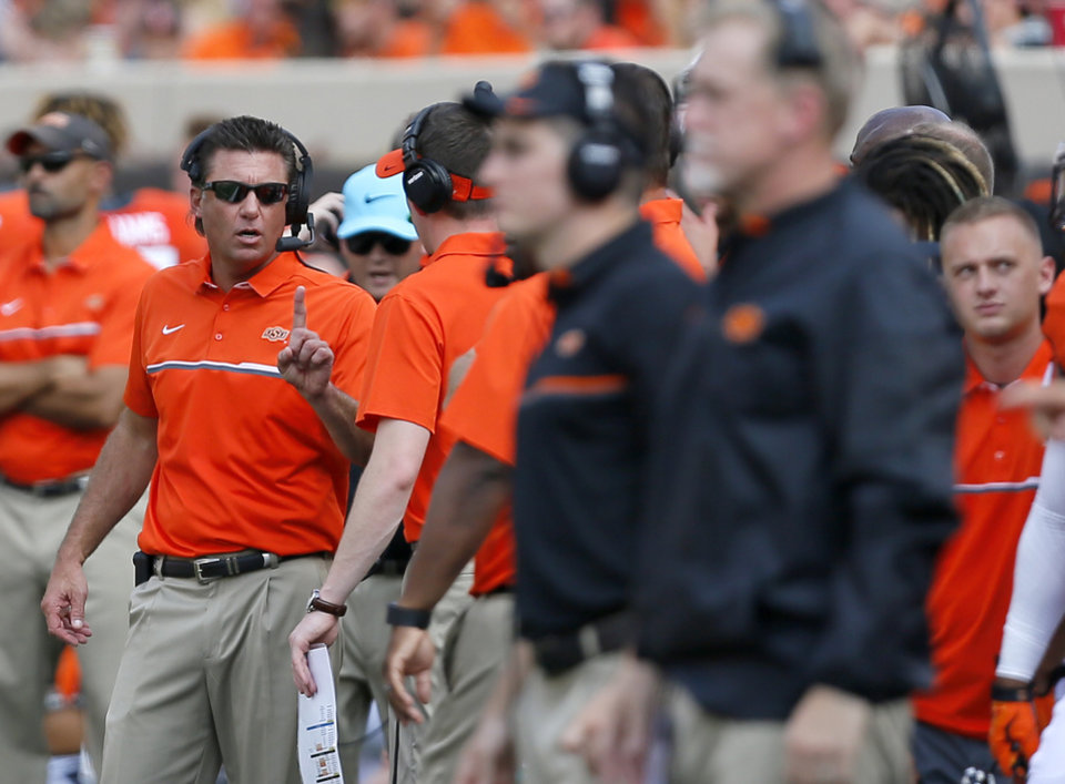Photo - Oklahoma State head coach Mike Gundy coaches from the sidelines during the college football game between the Oklahoma State Cowboys (OSU) and the Southeastern Louisiana Lions at Boone Pickens Stadium in Stillwater, Okla., Saturday, Sept. 12, 2015. Photo by Sarah Phipps, The Oklahoman