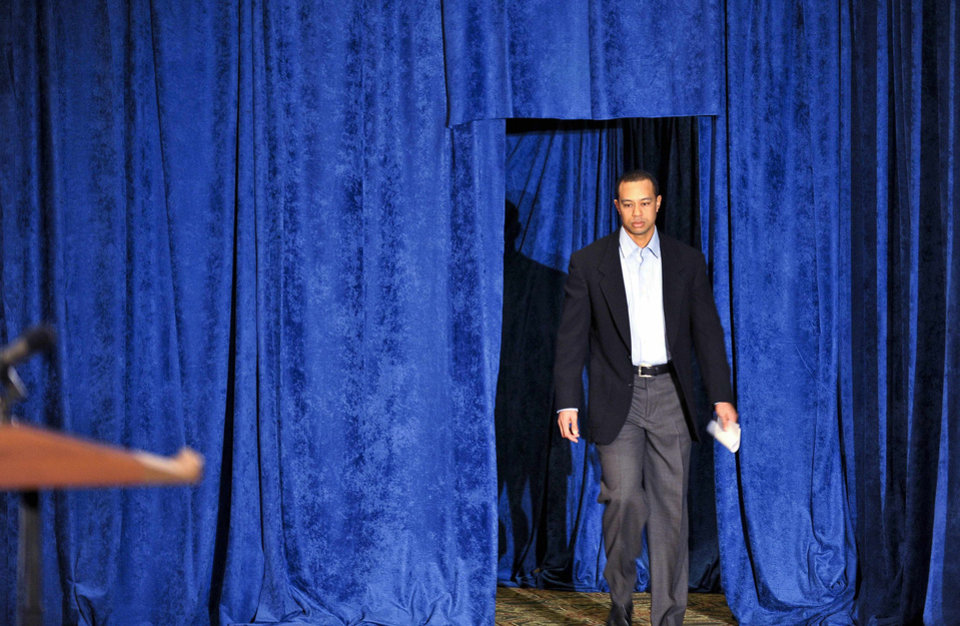 Photo - Tiger Woods arrives to make a statement at the Sawgrass Players Club, Friday, Feb. 19, 2010, in Ponte Vedra Beach, Fla. (AP Photo/Lori Moffett, Pool) ORG XMIT: TWP121