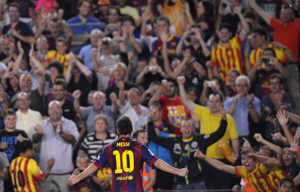 Photo - FC Barcelona's Lionel Messi, from Argentina, reacts after scoring against Elche during a Spanish La Liga soccer match at the Camp Nou stadium in Barcelona, Spain, Sunday, Aug. 24, 2014. (AP Photo/Manu Fernandez)