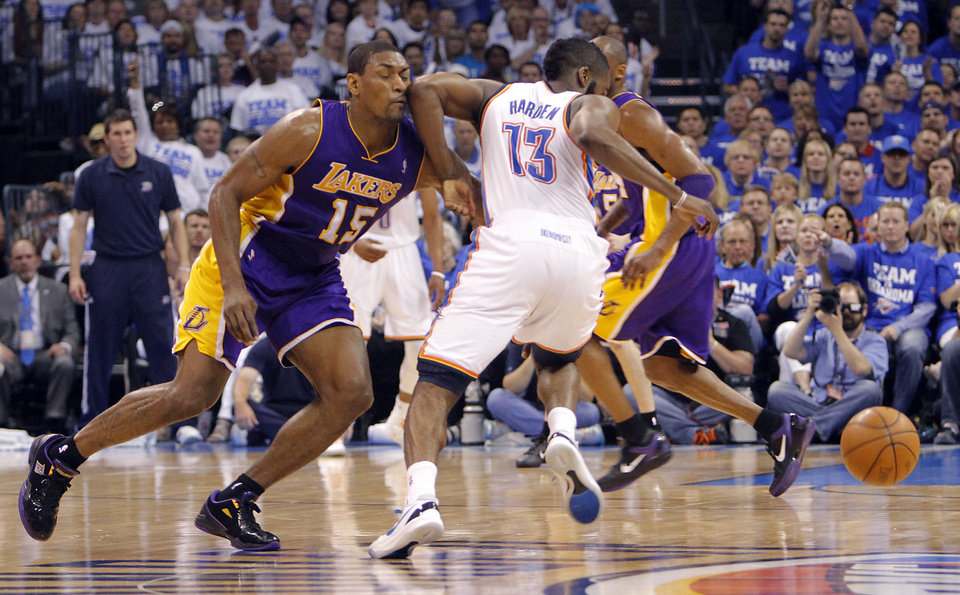 Photo - Oklahoma City's James Harden elbows Los Angeles' Metta World Peace during Game 2 in the second round of the NBA playoffs between the Oklahoma City Thunder and the L.A. Lakers at Chesapeake Energy Arena on Wednesday,  May 16, 2012, in Oklahoma City, Oklahoma. Photo by Chris Landsberger, The Oklahoman