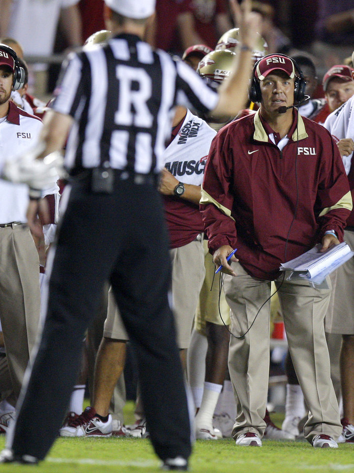 Photo - Florida State coach Jimbo Fisher watches an official during a college football game between the University of Oklahoma (OU) and Florida State (FSU) at Doak Campbell Stadium in Tallahassee, Fla., Saturday, Sept. 17, 2011. Oklahoma won 23-13. Photo by Bryan Terry, The Oklahoman