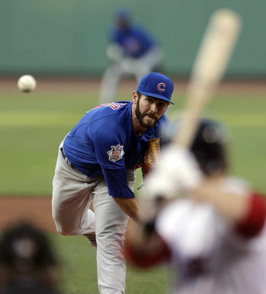 Photo - Chicago Cubs starting pitcher Jake Arrieta delivers against the Boston Red Sox during the first inning of a baseball game at Fenway Park in Boston, Monday, June 30, 2014. (AP Photo/Charles Krupa)