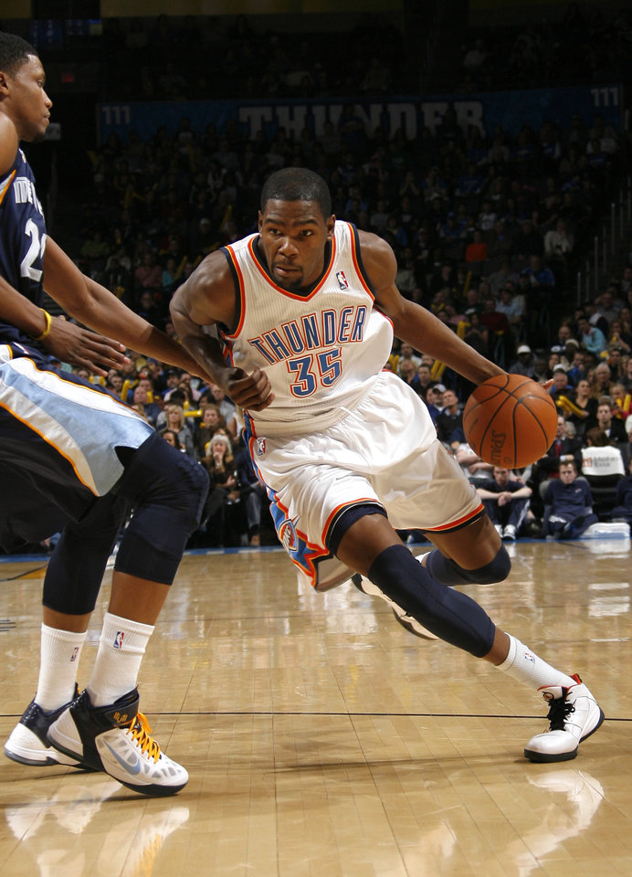 Oklahoma City's Kevin Durant (35) drives past Memphis' Rudy Gay (22) during the NBA basketball game between the Oklahoma City Thunder and the Memphis Grizzlies, Saturday, Jan. 8, 2011, at the Oklahoma City Arena. Photo by Sarah Phipps, The Oklahoman