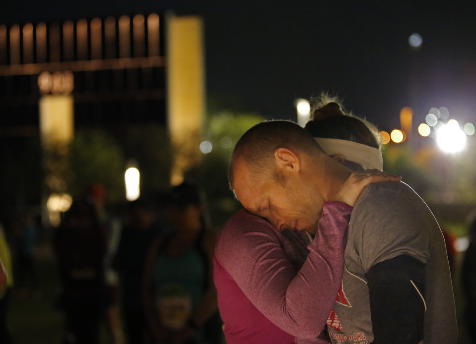 Photo - Katey and Brian Watson pray during the Sunrise Service before the Oklahoma City Marathon in Oklahoma City,  Sunday, April 29, 2018. Photo by Sarah Phipps, The Oklahoman
