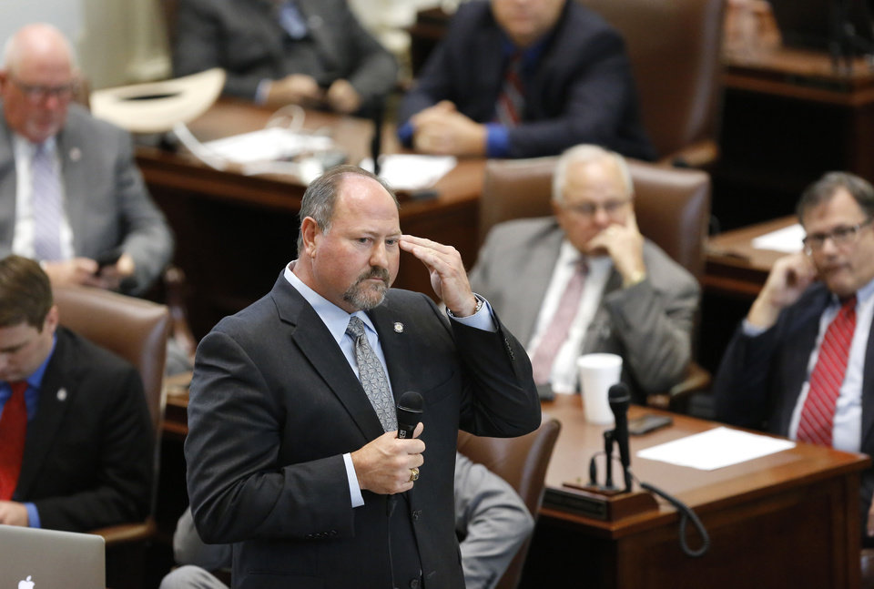 Photo - State Rep. Kevin Wallace answers questions during House action on Wednesday before lawmakers voted down a $132-million funding bill. Photo by Jim Beckel, The Oklahoman