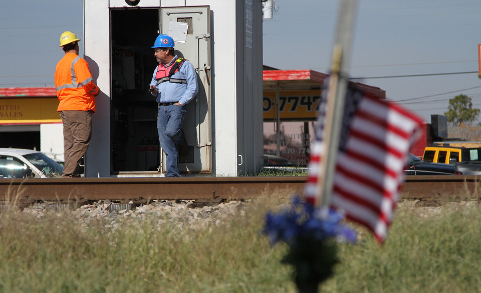 Railroad investigators work the scene of an accident where four veterans were killed and 16 other people were injured when a train slammed into a parade float carrying the returning heroes to a banquet last Thursday in Midland, Texas on Saturday, Nov. 17, 2012. Federal investigators were trying to determine whether the two-float parade had been given enough warning to clear the tracks. (AP Photo/Juan Carlos Llorca)