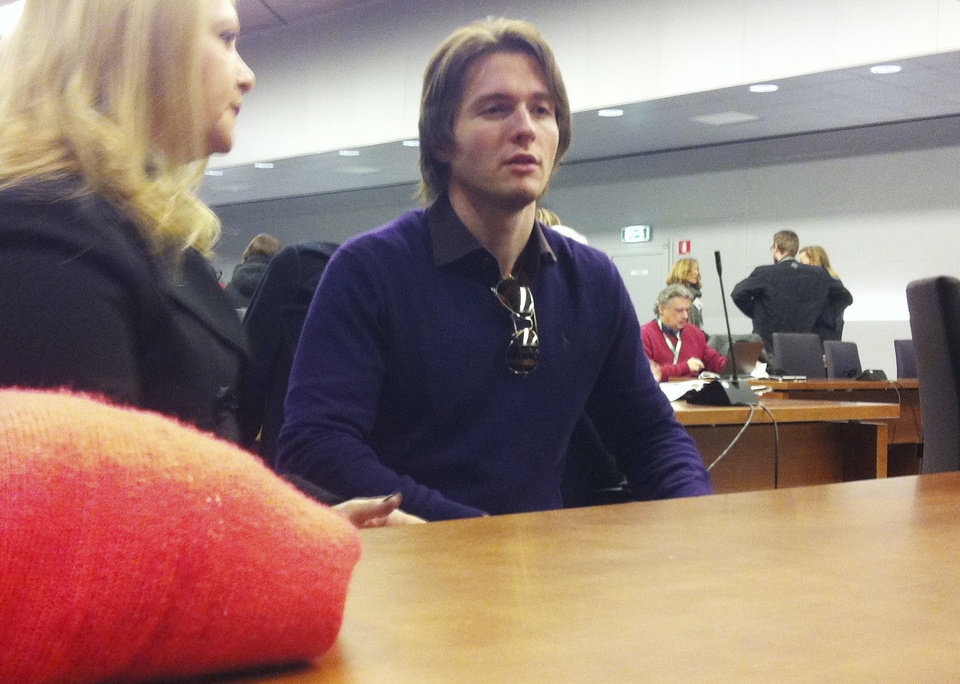 Photo - Raffaele Sollecito talks with his stepmother Mara Papagni prior to the start of the final hearing before the third court verdict for the murder of British student Meredith Kercher, in Florence, Italy, Thursday, Jan. 30, 2014. The first two trials produced flip-flop verdicts of guilty then innocent for Kercher former roommate, American student Amanda Knox, who is not attending the hearing,  and her former Italian boyfriend, Raffaele Sollecito, and the case has produced harshly clashing versions of events. A Florence appeals panel designated by Italy's supreme court to address issues it raised about the acquittal is set to deliberate Thursday, with a verdict expected later in the day. (AP Photo/Fabrizio Giovannozzi)
