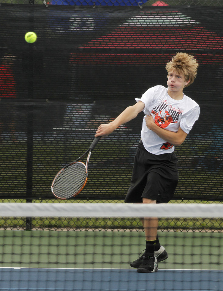 Photo - Patrick Wilson, of Booker T. Washington, competes in 5A Boys Singles during the 2012 OSSAA Boys High School State Tennis Tournament at the OKC Tennis Center at Will Rogers Park in Oklahoma City, Saturday, May 12, 2012.  Photo by Garett Fisbeck, For The Oklahoman