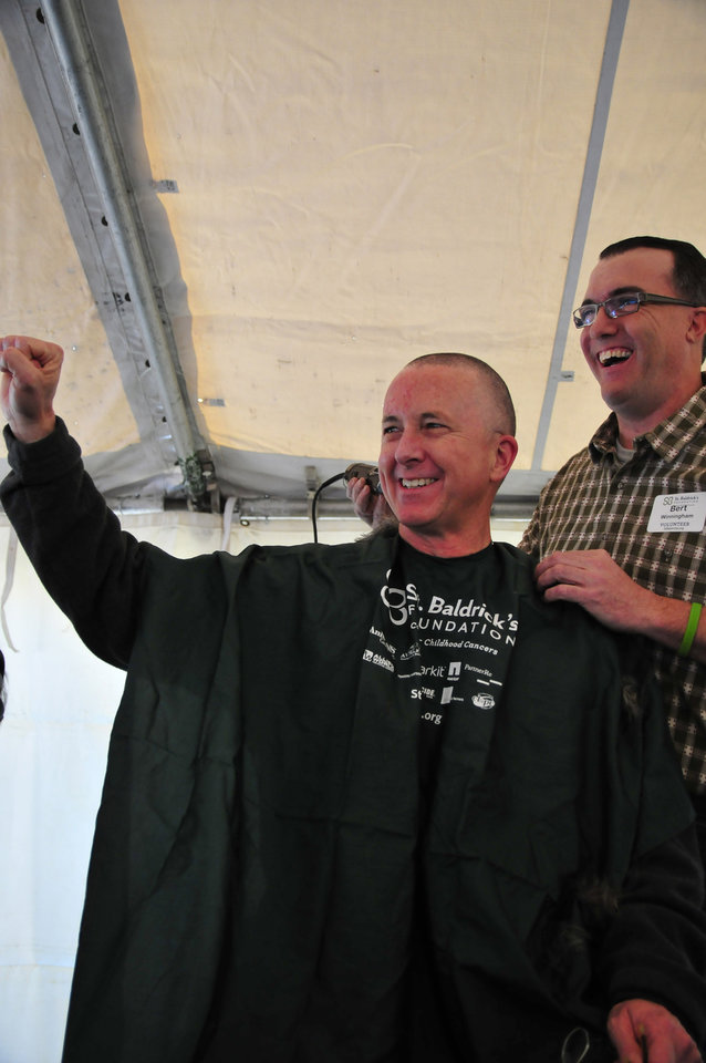 Steven Matthews, a member of Team Mayflower, gets his head shaved in order to help raise money for the St. Baldrick's charity at VZD's Restaurant and Club in Oklahoma City, Okla. Sunday, March 23, 2013.  Photo by Nick Oxford, for The Oklahoman