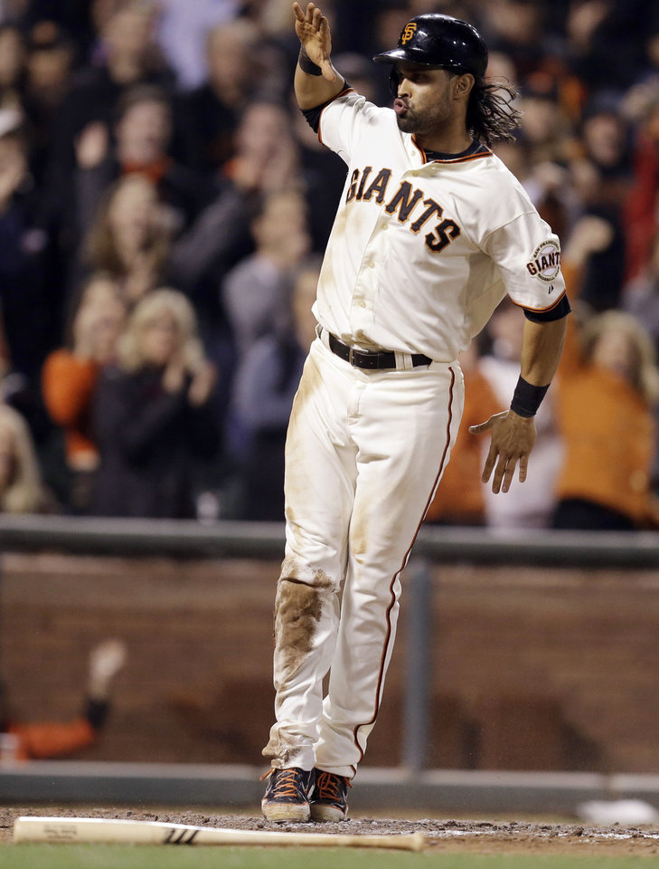 Photo - San Francisco Giants' Angel Pagan celebrates after scoring against the Colorado Rockies in the seventh inning of a baseball game Wednesday, Aug. 27, 2014, in San Francisco. Pagan scored on a single by Buster Posey. (AP Photo/Ben Margot)