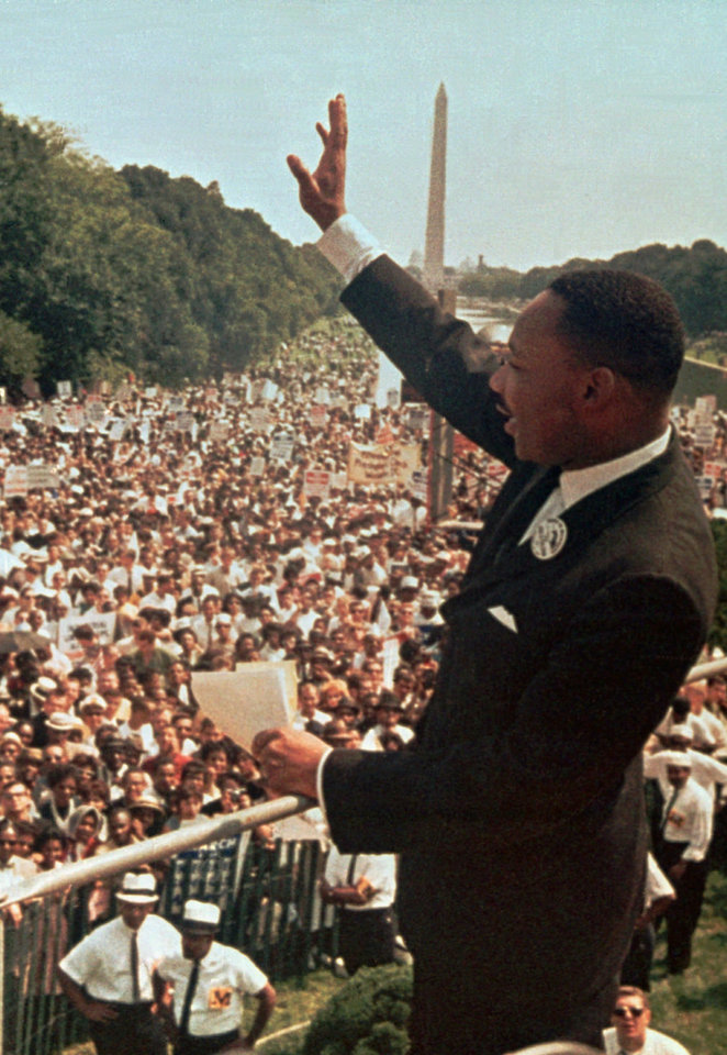 Photo -   The Rev. Martin Luther King Jr. acknowledges the crowd Aug. 28, 1963, at the Lincoln Memorial for his