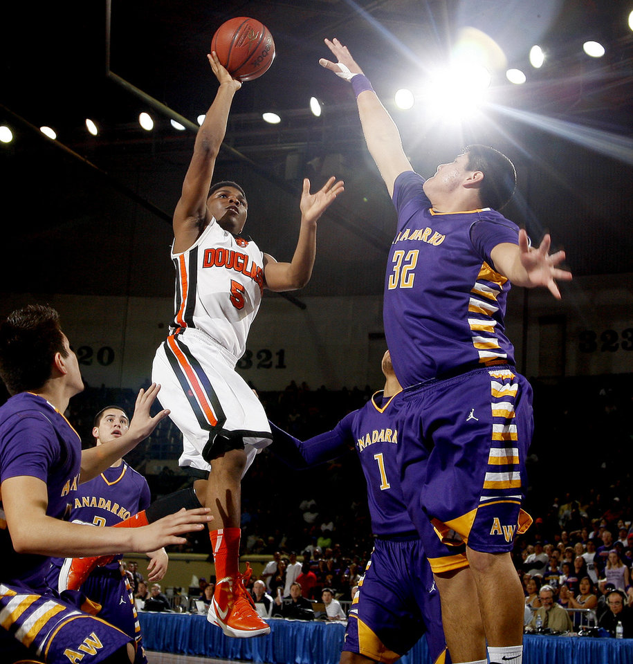 Photo - Stephen Clark of Douglass puts up a shot beside Anadarko's Randy Martinez, at right, during the Class 4A boys high school state basketball championship game at State Fair Arena in Oklahoma City, Saturday, March 10, 2012. Photo by Bryan Terry, The Oklahoman