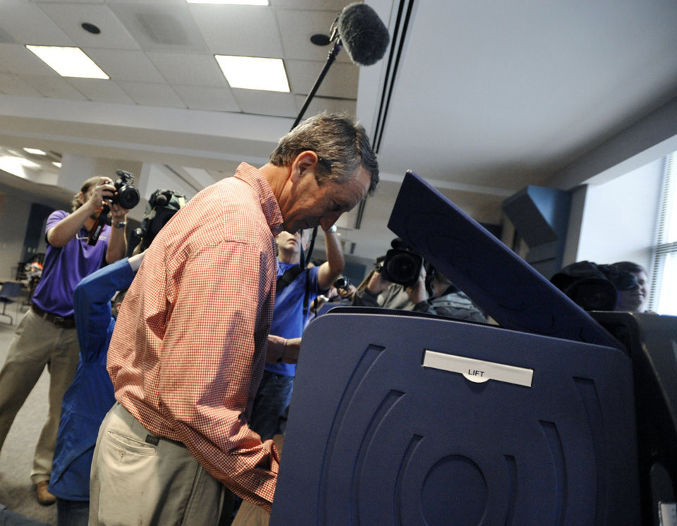 Photo - Former South Carolina Gov. Mark Sanford votes at a polling place in Charleston, S.C., Tuesday, May 7, 2013.  Sanford, a Republican, and Colbert Busch, a Democrat and sister of political satirist Stephen Colbert, are to face off for the 1st Congressional District seat, that was vacated when Tim Scott was appointed to the U.S. Senate. Green Party candidate Eugene Platt also is on the ballot.  (AP Photo/Rainier Ehrhardt)