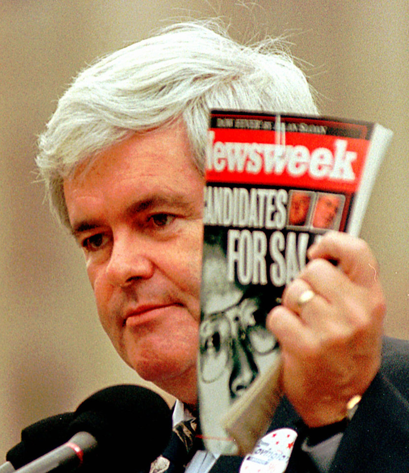Photo -   FILE - In this Thursday, Oct. 24, 1996 file photo, House Speaker Newt Gingrich, R-Ga., holds a copy of Newsweek Magazine and makes comments about President Clinton and the Democratic party in Jackson, Miss. Newsweek announced Thursday, Oct. 18, 2012 that it will end its print publication after 80 years and shift to an all-digital format in early 2013. Its last U.S. print edition will be its Dec. 31 issue. The paper version of Newsweek is the latest casualty of a changing world where readers get more of their information from websites, tablets and smartphones. It's also an environment in which advertisers are looking for less expensive alternatives online. (AP Photo/Dan Loh, File)