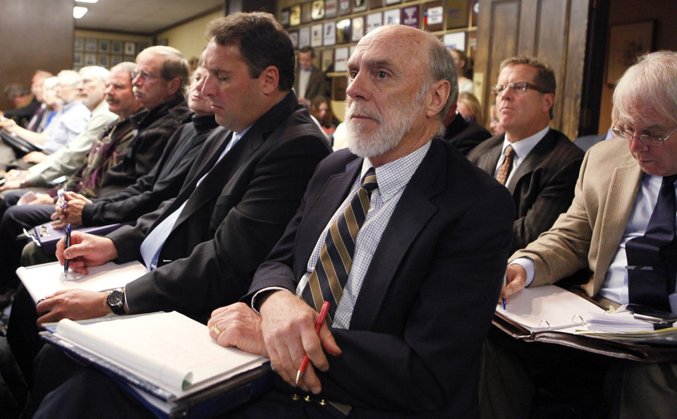 Routt County attorney John Merrill, foreground, listens with others at a meeting of the Colorado Oil and Gas Conservation Commission in Denver on Wednesday, Nov. 14, 2012. Groundwater tests could help show whether water has or hasn't been contaminated by drilling. (AP Photo/Ed Andrieski)