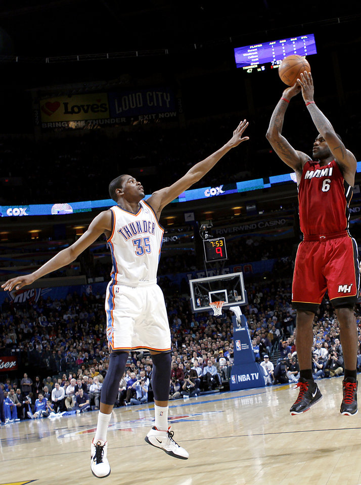 Photo - Oklahoma City's Kevin Durant guards Miami's LeBron James during their NBA basketball game at the OKC Arena in Oklahoma City on Thursday, Jan. 30, 2011. Photo by John Clanton, The Oklahoman