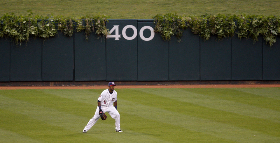Photo - IVY-COVERED WALL: RedHawks centerfielder Julio Borbon watches the pitch with a background of ivy on the outfield wall during the minor league baseball game between the Oklahom City RedHawks and the New Orleans Zephyrs at AT&T Bricktown Ballpark Friday, May 1, 2009. Tonight was Taste of the Big Leagues night featuring Wrigley Field in Chicago. Photo by Doug Hoke, The Oklahoman ORG XMIT: KOD