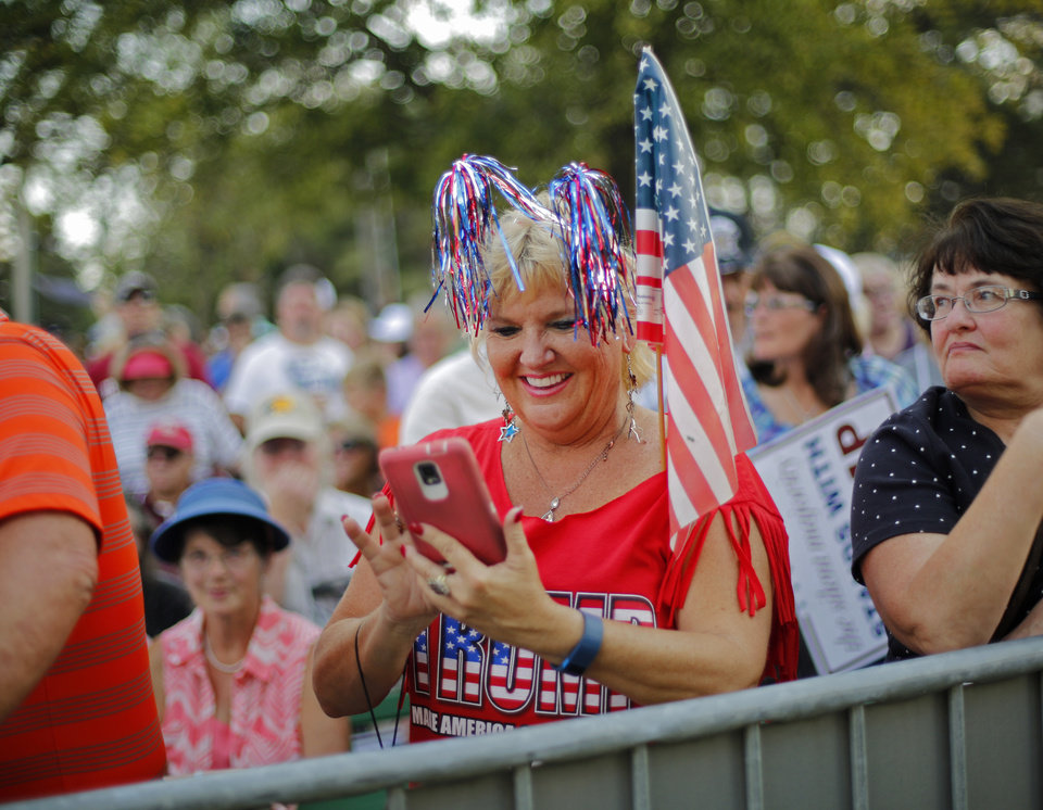 Photo - Debi Norris waits for Republican presidential candidate Donald Trump before a rally at the Oklahoma State Fair in Oklahoma City, Friday, September 25, 2015. Photo by Bryan Terry, The Oklahoman
