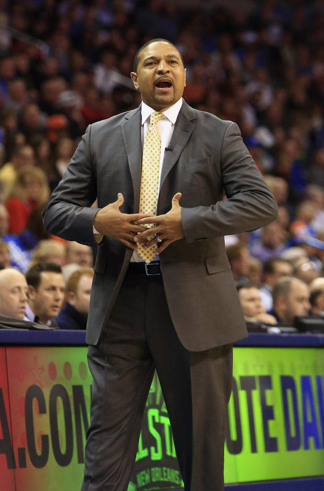 Photo - Golden State Warriors head coach Mark Jackson coaches his team against the Oklahoma City Thunder during the third quarter of an NBA basketball game Friday, Jan. 17, 2014, in Oklahoma City. (AP Photo/Alonzo Adams)