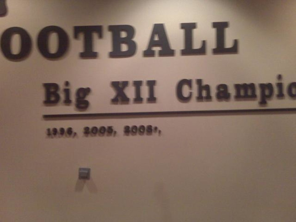 Photo - UNIVERSITY OF OKLAHOMA / OU / TEXAS / COLLEGE FOOTBALL: The asterisk:  April 2009: Official records show Oklahoma won the 2008 Big 12 Championship after beating Missouri 62-21. Someone on Texas' staff must have missed the memo. The year 2008 was at the end of a list of the Longhorns' Big 12 titles on a wall of the team's practice facility. Next to an asterisk, of course. A day after reporters wrote about the claimed title in April, it came down. Texas coach Mack Brown said he had no knowledge of the new wall decoration and didn't approve of it.   ORG XMIT: 0910152203575022