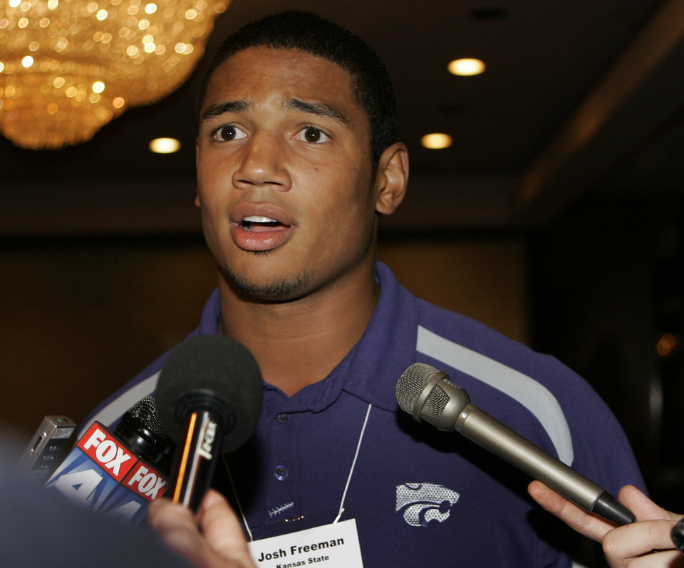 Photo - COLLEGE FOOTBALL: Kansas State University quarterback Josh Freeman listens to a reporters question during Big 12 Football Media Days in Kansas City, Mo., Tuesday, July 22, 2008. (AP Photo/Orlin Wagner) ORG XMIT: MOOW111
