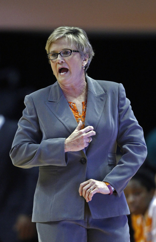 Photo - Tennessee coach Holly Warlick yells to her team during the first half of an NCAA college basketball game against LSU on Thursday, Jan. 2, 2014, in Knoxville, Tenn. LSU won 80-77. (AP Photo/Wade Payne)