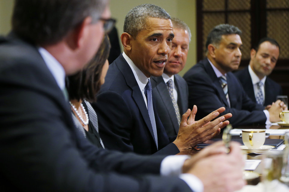 Photo - President Barack Obama meets with business leaders about creating and investing in jobs in the U.S. Tuesday, May 20, 2014, in the Roosevelt Room of the White House in Washington. From left are: Carsten Spohr, Chairman and CEO, Deutsche Lufthansa AG; Ravila Gupta, President, Umicore USA; the president; Joe Hinrichs, Executive Vice President and President of the Americas, Ford Motor Company; Sanjay K. Jha, CEO, Globalfoundries; Michael Penner, President, Richelieu. (AP Photo/Charles Dharapak)