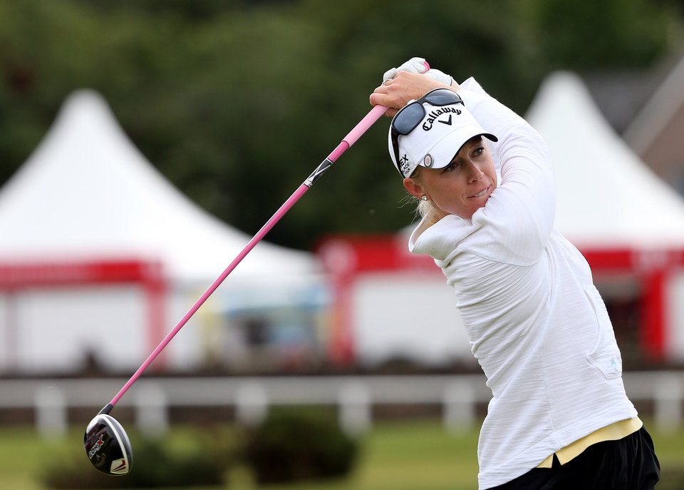Photo - Morgan Pressel of the USA, tees off on the second hole during the first round of the Women's British Open golf championship on the Old Course at St Andrews, Scotland, Thursday Aug. 1, 2013. (AP Photo/Scott Heppell)
