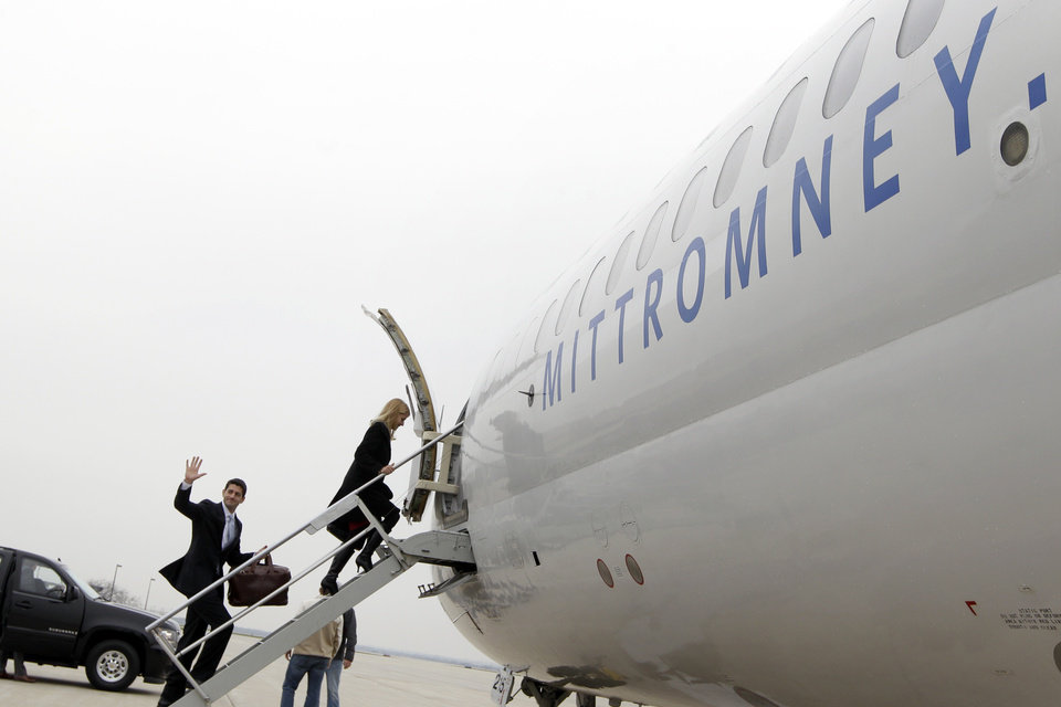 Republican vice presidential candidate, Rep. Paul Ryan, R-Wis., waves as he follows his wife Janna as they board the campaign charter airplane in Janesville, Wis., Tuesday, Nov. 6, 2012. (AP Photo/Mary Altaffer)