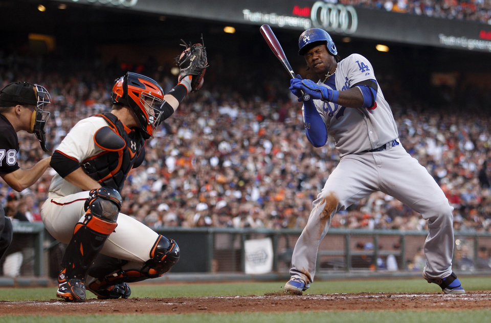 Photo - Los Angeles Dodgers' Hanley Ramirez, right, dodges a high pitch from San Francisco Giants pitcher Ryan Vogelsong during the sixth inning of a baseball game on Saturday, July 26, 2014, in San Francisco. (AP Photo/Beck Diefenbach)