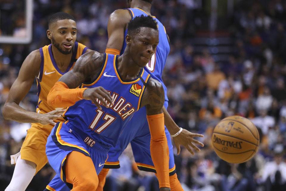 Photo - Oklahoma City Thunder guard Dennis Schroder (17) dribbles past Phoenix Suns forward Mikal Bridges, left, during the first half of an NBA basketball game Friday, Jan. 31, 2020, in Phoenix. The Thunder defeated the Suns 111-107. (AP Photo/Ross D. Franklin)
