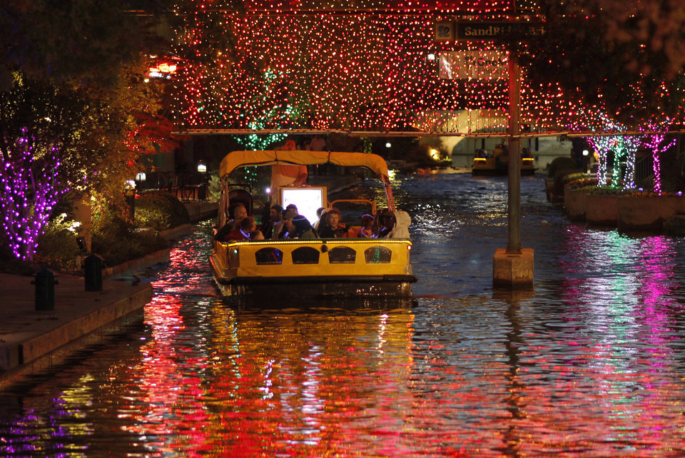 Photo -  People enjoy the free canal boat rides under the holiday lights during the OneMain Financial Lights the Bricktown Canal event, which is part of Downtown in December in Oklahoma City Saturday, November 19, 2011. Photo by Doug Hoke, The Oklahoman