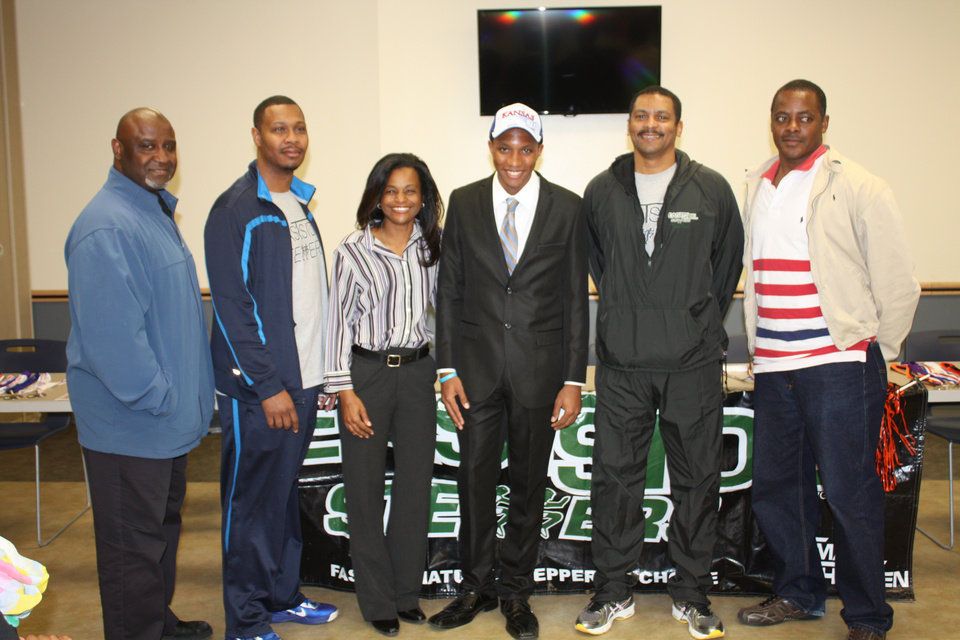 Photo -  Anthonio Humphrey with his coaches from the Eastside Steppers track club. Photo provided