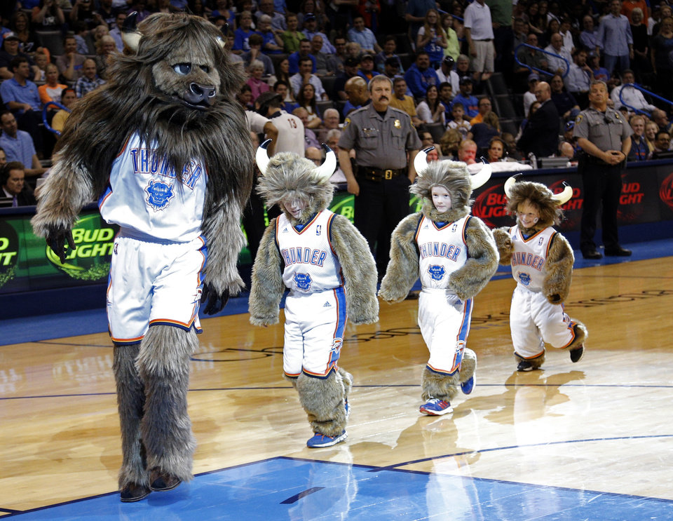Photo - Rumble get help from junior Rumbles during a time out at the NBA game between the Oklahoma City Thunder and the Utah Jazz at the Chesapeake Energy Arena, Sunday, March 30, 2014, in Oklahoma City. Photo by Sarah Phipps, The Oklahoman