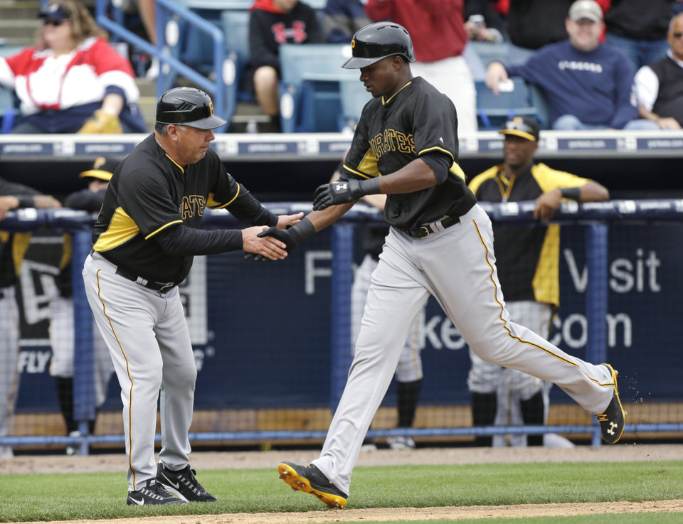 Photo - Pittsburgh Pirates right fielder Gregory Polanco is greeted by third base coach Nick Leyva, left, after hitting a home run during the first inning of an exhibition baseball game against the New York Yankees Thursday, Feb. 27, 2014, in Tampa, Fla. (AP Photo/Charlie Neibergall)