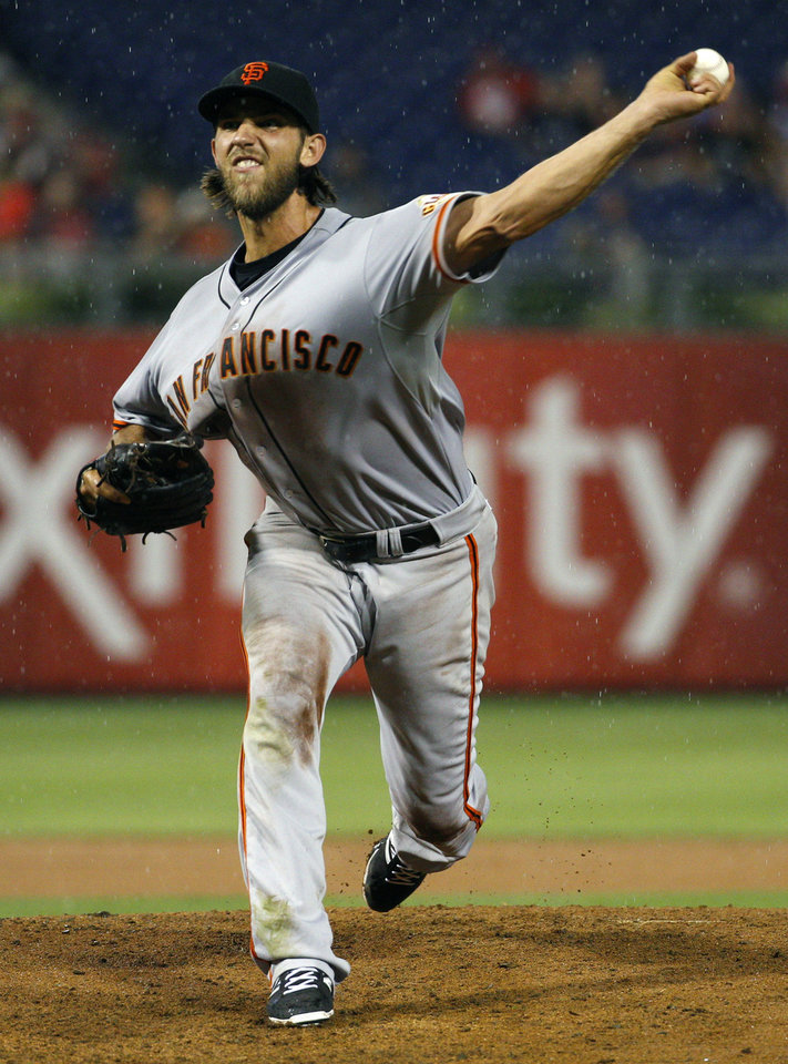 Photo - San Francisco Giants starting pitcher Madison Bumgarner pitches in the rain during the fifth inning of a baseball game against the Philadelphia Phillies, Wednesday, July 23, 2014, in Philadelphia. (AP Photo/Chris Szagola)