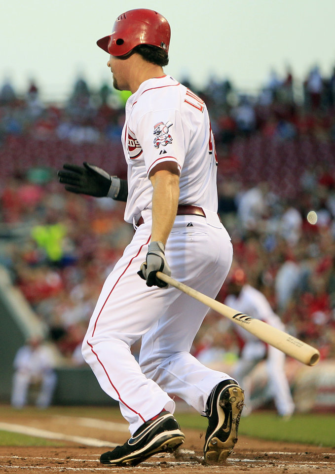 Photo -   Cincinnati Reds' Ryan Ludwick watches his bases-loaded hit that drove in two runs in the first inning of a baseball game against the Houston Astros, Friday, Sept. 7, 2012, in Cincinnati. (AP Photo/Al Behrman)