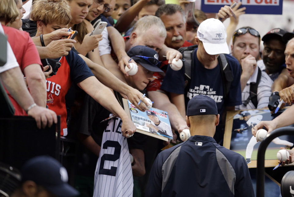 Photo - New York Yankees' Derek Jeter signs autographs before a baseball game between the St. Louis Cardinals and the Yankees on Wednesday, May 28, 2014, in St. Louis. (AP Photo/Jeff Roberson)
